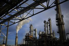 Oil rose, reversing an earlier decline, on speculation Iran may be more willing…
