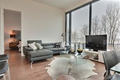 Evolo 2 - Salon moderne aménagé par Anne-Marie Jean, designer Condominium, Tour, Salons, Outer Space, Lounges