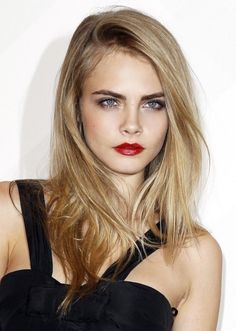 Blonde hair with depth at the root and a dark eyebrow to boot