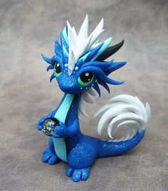 My next sale's theme is dragons with pets, and so far this little guy is my favorite. Dragon with Ball Python Polymer Clay Kunst, Polymer Clay Dragon, Polymer Clay Figures, Cute Polymer Clay, Polymer Clay Animals, Cute Clay, Polymer Clay Projects, Polymer Clay Creations, Little Dragon