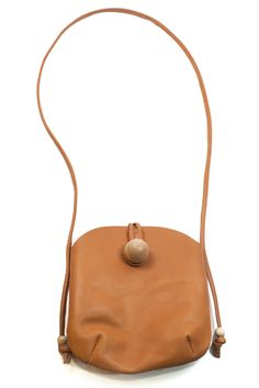 I adore the uniqueness of this bag and that tan color- yes please!
