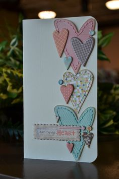 Card by Ali Davis.    I love, love, love all the embroidered hearts! - Seriously I need to learn to sew.