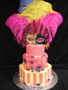 Mardi Gras galore! Turn your Sweet 16 cake into a centerpiece, complete with a mask and larger-than-life feathers. @PartyFlavors #PartyFlavors