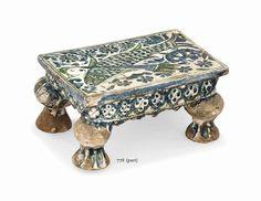 a_qajar_pottery_stool_a_qajar_gun_barrel_and_a_bukhara_vase_iran_and_c_d5671781g.jpg (1024×790)