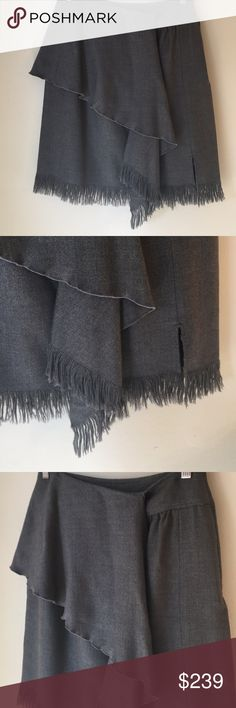 ❤️VALENTINO SKIRT 💯AUTHENTIC VALENTINO LOVELY GRAY FRINGED SKIRT 100% AUTHENTIC! TRUE SUPER HIGH END LUXURY! THE SKIRT IS A SIZE 12. THE WAIST MEASURES 26 INCHES AROUND. THE HIP MEASURES 22 INCHES ACROSS AND 44 INCHES AROUND. THE LENGTH OF THE SKIRT 21.5 INCHES LONG. PLEASE FEEL FREE TO ASK QUESTIONS. Valentino Skirts