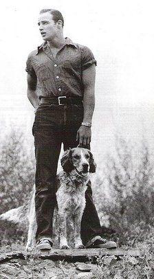 Marlon Brando with family dog, Illinois, early 1950s.
