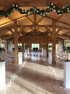 Classic white wooden aisle pillars make a beautiful entrance. #piecesandposies