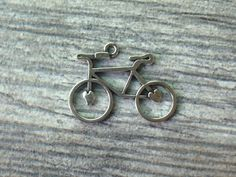 A personal favorite from my Etsy shop https://www.etsy.com/listing/234985986/silver-tone-bike-charms