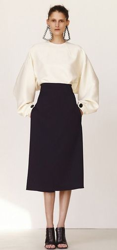 black skirt, fabulous white blouse with button cuffs and EARRINGS!