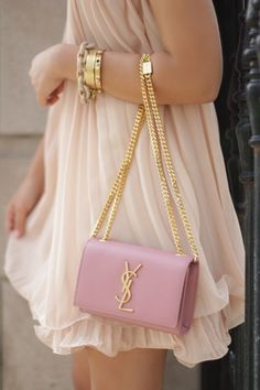 Blush dress, cute bracelets, and chanel bag