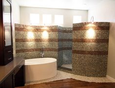 """Make an """"S"""" with tub in one curve and shower in other.  Put windows above with tile all the way up and on ceiling."""