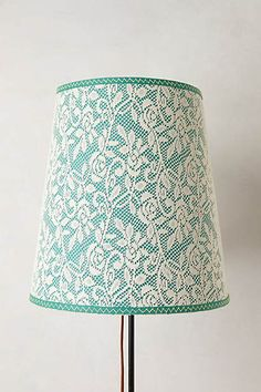 Veiled Lampshade. DIY idea: overlay lace on a colored lampshade for a feminine effect. More DIY lamp ideas at pinterest.com/ilikethatlamp