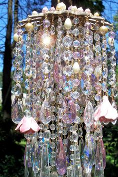 On hold until 6/20...    Everything lovely for a Summer Goddess! This large luscious wind chime explodes in sparkles and has sweet, sweet melodic tones.    Antique cut~out brass top is jeweled on the top with pink aurora borealis crystals, pale gold crystal pearls, pale pink crystal pearls, and cream glass pearls. These help to hold the three beautiful layers of crystal pearl and bead strands that surround the piece in total loveliness. There are pink crystals, clear crystals, golden and…