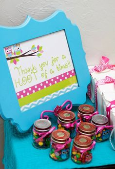 Colorful owl birthday party. These candy filled party favors are cute. Love the sign, too!