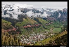 Box canyon surrounded by snowy mountains in spring. Telluride, Colorado, USA (color)