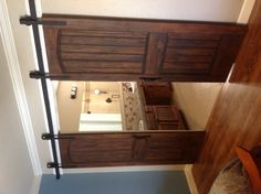 Our Barn doors! Stained contractor grade cabinets and faux granite countertop. -k