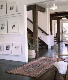 huge timber beams & floating shelves for art
