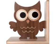 Our finely handcrafted wooden Owl Bookend is an adorable family heirloom piece perfect for a baby nursery or kids room. Our unique mixed wood composition brings richness, warmth and traditional cute style to any environment. This cutie is reversible.  Orson the Owl Bookend measures 7 x 7 x 3.25 and is ready to proudly perch on your shelf. Endowed with plenty of engaging cuteness, charming originality and unsurpassed quality, each product is lovingly handmade in our family wood shop. We use…