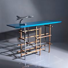Concorde, console. Blue lacquered top with rough teak wood and polished stainless steel base.  Designed By:  Ardeco Studio~Georges Amatoury. To be ordered online through www.levantania.com