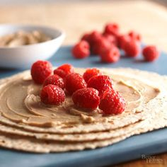 Fat-free yogurt and creamy peanut butter combine to add a boost of protein to your afternoon snack. Simply spread the mix atop a whole wheat tortilla and add some fresh raspberries or strawberries to make our delicious version of PB&J. Protein amount: 8 grams