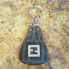 FINAL MARKDOWN ****FENDI KEYCHAIN Authentic FENDI ZUCCA KEYCHAIN  USED A LOT/ A LOT OF LOVE LEFT  AS YOU CAN SEE IN PICS 1 AND 2 THE FABRIC HAS WORN OFF /BUT IF YOUR CREATIVE A DARK BROWN FABRIC MARKER  CAN AT LEAST PUT SOME COLOR BACK TO IT!  ITS FENDI SO THE HARDWARE IS VERY DURABLE! FENDI Accessories Key & Card Holders
