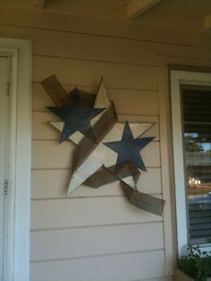 Stars made from a car hood, ribbon is metal screen from a refrigeration case.