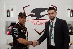 Dragon Racing managing director Oriol Servia and the strategic development director of InstaForex Roman Tsepelev shake hands celebrating long-term agreement (PRNewsFoto/InstaForex)