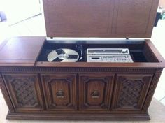 8 track record player cabinet.  We had a large cabinet like this when I was a kid.  Ha!