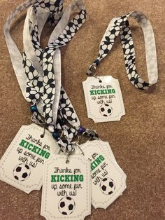 Soccer party favor giveaways. Opting out of the bags filled with candy & small toys. Ribbon, bead, ring, & tags.