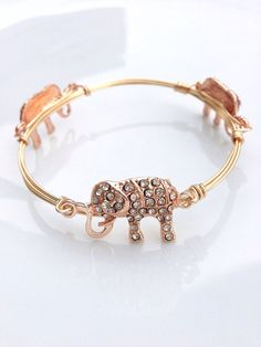 The Water for Elephants gold bauble bangle on Etsy, $12.99