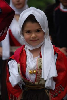 A beautifully attired little girl in traditional Sardinian clothing.
