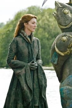 Michelle Fairley as Catelyn Stark-A line tight bodices with asymetrical cleeve details, self colours and firmly woven fabrics