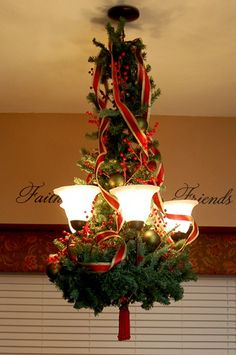 One thing I don't like is decorating my dining room table & chandelier.  I've seen a million different ways to decorate a chandelier...greenery, beading, hanging ornaments, etc., etc., etc. Here's how I had my chandelier decorated last year & the start of this season…