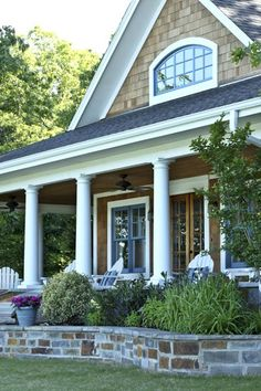 Cedar shingle siding, white trim, stone porch