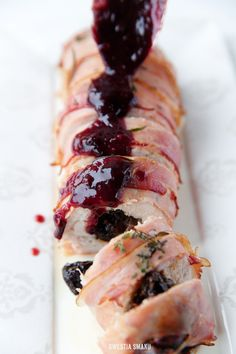 Turkey breast filled with dried plums wrapped in prosciutto in red wine and plum sauce