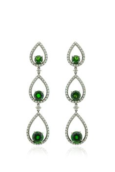 Elegant, simple, very light, evergreen, emerald green for the titanium and gold earrings available at Phillips New York. Bid online or go at 450 Park Avenue New York to assist directly at the auction
