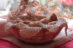 wicker basket with seed bread on the table rustic tablecloth