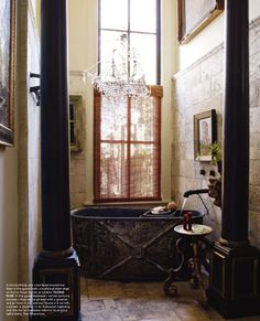 rustic-elegant.  not sure about the columns, but I guess with the excess height you need something to bring it in and make it cosy.