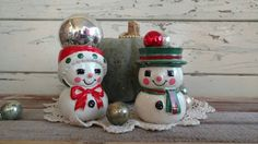 Check out this item in my Etsy shop https://www.etsy.com/listing/171391054/kitsch-vintage-snowmen-candle-holders