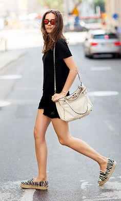 Black t-shirt, black shorts, and animal-print espadrilles
