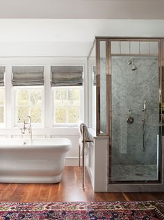 The master bath echoes the soft blues and neutrals used in the living spaces. PHOTO: Sam Frost.