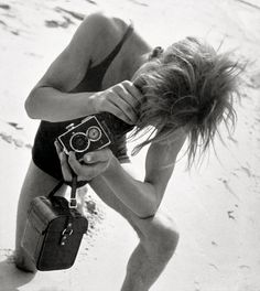 Eva Besnyö - John Fernout with Rolleiflex at the Baltic seaside, 1932. °