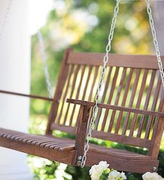 Classic Slatted Wood Porch Swing in the white