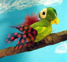 Painted clay bird with real feathers