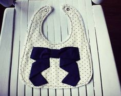 Navy Falling Bow on Cream Fabric w/ Navy Polka Dots - White Terry Cloth back- girl bib