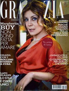 The cover of GRAZIA featuring Italian actress Margherita Buy in a silk satin cross dress with contrasting panels and double waist sash. • GRAZIA, Italy - April 6, 2016