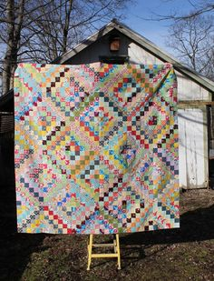 I finished my scrappy trip around the world quilt top this week, and I have to say, I kind of love it. I ended up taking out two darker b...