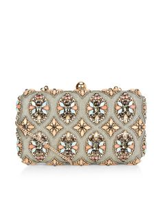 Beautifully embellished with crystal gems in an Art Deco-inspired design, our Ava hard case clutch will add a touch vintage appeal to any occasion look. A touch of metallic shimmer creates a luxe finish. Carry yours in hand or wear it on your shoulder using the concealable chain strap.