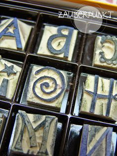 Stamps handmade - must make my own alphabet (and are they stored in a box of chocolates?)