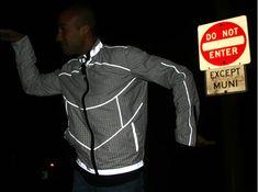Reversible TRON-inspired jacket reflects light for safer night biking.